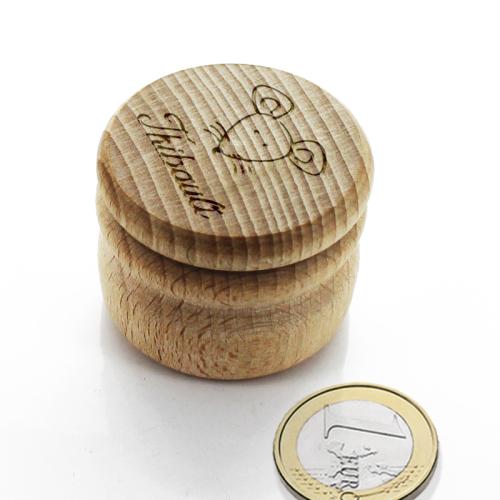 Traditionnelle boite à dent en bois ronde