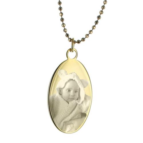 Pendentif ovale photo en métal doré